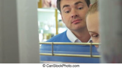 Man and woman in the perfumery - Close-up shot of young...