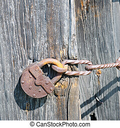 old padlock on the ramshackle doors