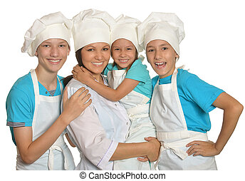 family posing in chef uniforms - Cute family posing in chef...