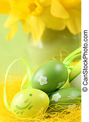 Green Easter eggs and daffodils - Green Easter eggs and...