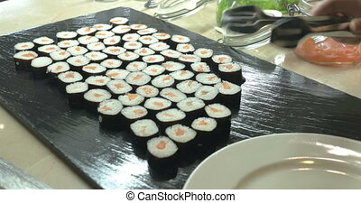 Sushi Rolls Served On Plate In Japanese Restaurant - Close...