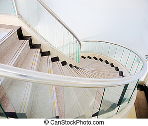 Spiral Stairs - Looking down at a spiral stair in a house