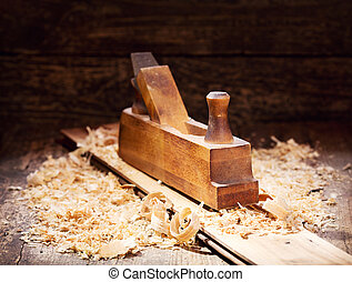 old wooden plane in a workshop - old retro wooden plane in a...