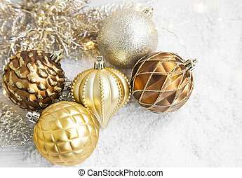 Golden Christmas Globes and Lights in the Snow - Golden...