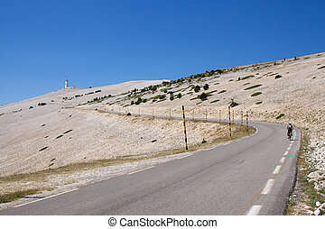 Mont Ventoux, France - A lone cyclist on the road to the...