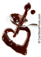 Melted dark chocolate on plate and steel spoon. Heart shape