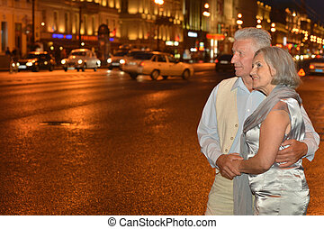 old couple on night street - Portrait of amusing old couple...
