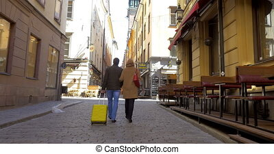 Two Tourists Walking in Stockholm - Steadicam follow shot of...