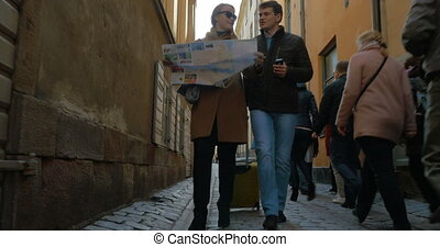 Tourists Walking Around The City Holding A Map