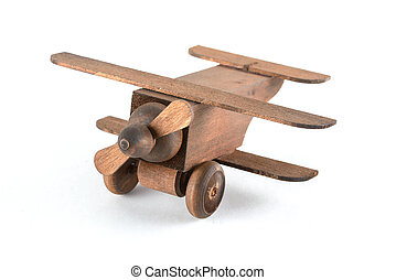 toy wooden plane close up isolated on white background