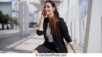Businesswoman taking a call on her mobile - Attractive...