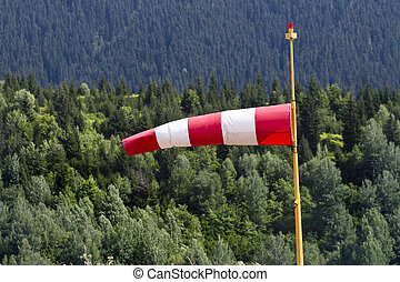 one windsock pole red and white