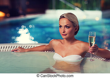 happy woman drinking champagne at swimming pool - people,...