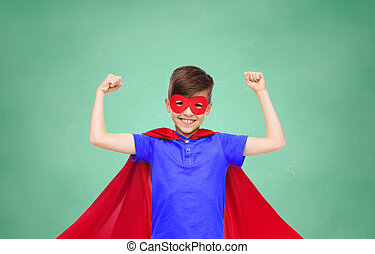 boy in red super hero cape and mask showing fists - school,...