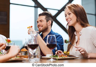 happy couple having dinner at restaurant - leisure, food and...