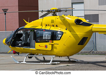 Yellow Emergency Helicopter, medical rescue team - flying...