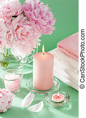 bath and spa with peony flowers candles towels