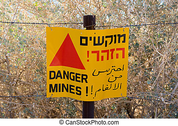 Warning sign with Danger Mines - A warning sign with Danger...