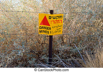 Warning sign with Danger Mines - A warning sign with 'Danger...