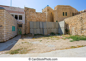 Blocks closing an alley - HEBRON, ISRAEL - 10 OCT, 2014:...