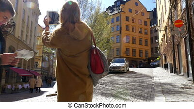 Two Tourists Walking in Stockholm - Steadicam shot of two...