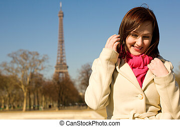 Happy beautiful woman in Paris at sunny spring day