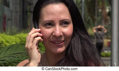 Hispanic Woman Talking on Mobile - Hispanic Woman Talking on...