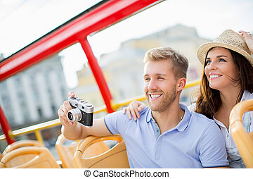 Smiling couple - Young smiling tourists with camera