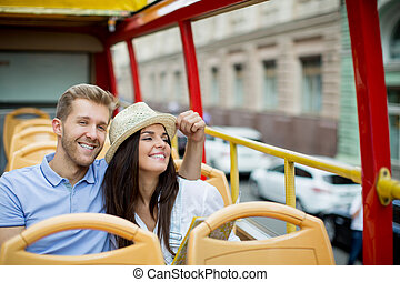 Travelling - Young tourists in a tourist bus