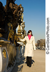 Beautiful girl in Paris on the Pont Alexandre III