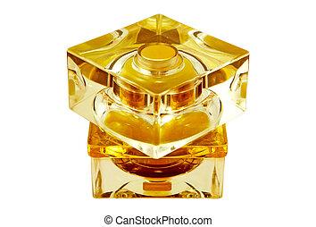 perfumery isolated - yellow bottle of perfume. Close-up....