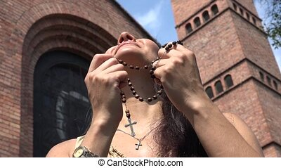 Christian Woman with Rosary Beads