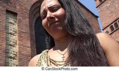 Woman Crying in front of Church