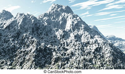 Aerial shot of snowy mountain peak