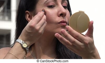 Woman Applying Makeup or Cosmetics