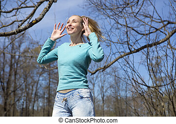 young woman in bright clothes jumps