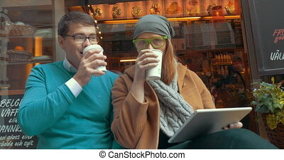 Young Friends Drinking Coffee-To-Go Outdoor - Two friends...