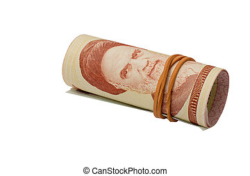 Rolled rial banknotes with a rubber ring, isolated