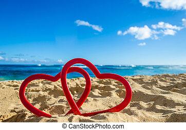 Two hearts on the sandy beach near ocean in Hawaii, Kauai -...