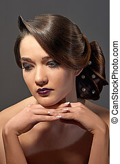 beautiful brunet woman with fashion hairstyle