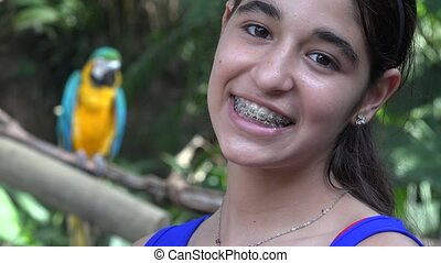 Teen Girl Smiling with Parrot