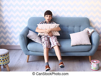 preteen boy in cozy bedroom interior