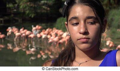 Sad Teen Girl with Flamingos