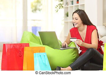Woman buying online with credit card - Woman buying online...