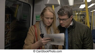 Adult Couple With A Map In The Metro Train - Tourist couple...