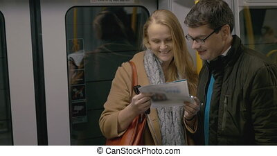 Tourist Couple With Attractions Guide - Adult couple with a...