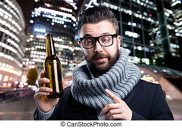 Young man with beer bottle - Young drunken man with a beer...