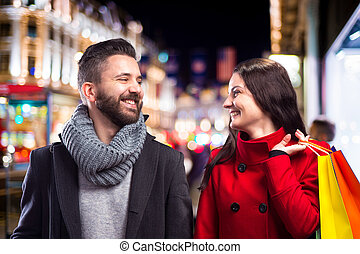 Beautiful couple in the city - Young beautiful couple buying...