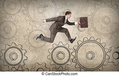 Man running on cog wheels on abstract background