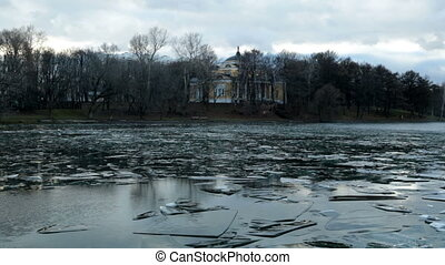 Pond with ice formed in December, and the old building HD